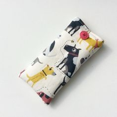 Glasses, sunglasses case, dogs on white background  £8.00