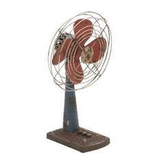 Check out the Woodland Imports 56156 Designed Metal Fan Decor in Rustic Appearance