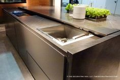 Retracting counter top hide sink range elements trend spotted at euro cucina  | The Decorating Diva, LLC #kitchen #design #trends