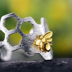 A Bee's honeycomb represents the Heart Chakra and life's sweetness. Bee has strong ties to the sun, light and warmth.💖🐝tap to see more💛Queen bee ring products bee jewelry honeycomb silver bee ring shops bumble bee ring unique Bee Jewelry, Jewelry Accessories, Handmade Jewelry, Jewellery, Bee Ring, Earring Trends, Big Earrings, Sterling Silver Earrings Studs, Unique Rings