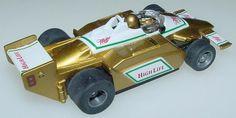 TYCO_440X2_MILLER_HIGHLIFE_INDY_RACER_F1_GOLD_GREEN_WHITE_RED_SLOT_CAR_RUNNER_SPOILER.JPG (576×290)
