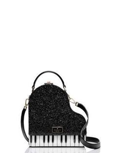 keyed up: this unique, glitter-dusted leather bag is shaped like a grand piano, for a look that's a little bit cheeky and very cool.