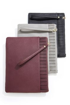 Flat wristlet clutches with laser cut eyelet details