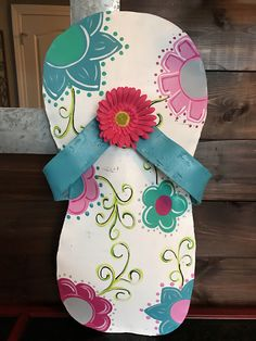 A personal favorite from my Etsy shop https://www.etsy.com/listing/532809133/flip-flop-door-hanger