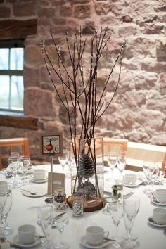 Could hang baubles or wrap lights round twigs in middle of table??? J  Cute table decor for a Christmas wedding