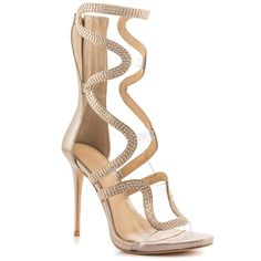 Shop now @heelsdotcom - Steal the spotlight in the Dash from Imagine by Vince Camuto. This shimmery gold sandal has winding snake like straps standing at 8 1/2 inches tall. A back zipper, 4 1/2 inch heel and tiny studs detail this sleek stiletto.