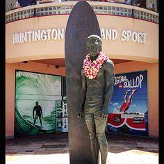 Surf icon Duke Kahanamoku at Huntington Surf and Sport, Huntington Beach, Orange, California by Thomas J. Story