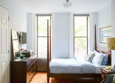 If you have a small bedroom, remove the curtains to make the space seem brighter and bigger.