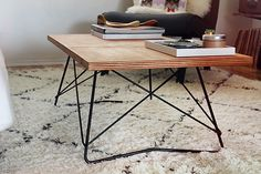 This diy coffee table can be created in a few steps. Paint the wood to fit in any decor.