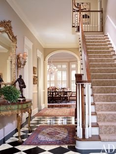 Traditional Entrance Hall by William W. Stubbs in Houston, Texas