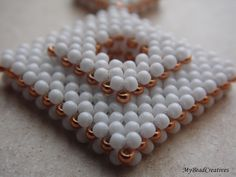 At some point in my beading history I was using right angle weave (RAW) on a daily basis without even realizing it. True enough I wasn't using seed beads back then, I made my jewelry more with face...