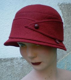 I'm looking for a wool cloche hat. Black, mainly, but red will do.
