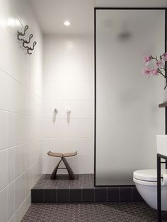 The bathroom - a windowless space in Carroll's small apartment - now features Deco-flavoured floor tiles and a simple shower area. Photograph by David Straight.