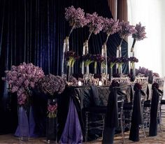 dark wedding. love the flowers at the end of the table and the chair wraps. very unique set up