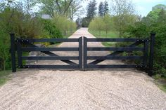 Black Post and Rail Wood Automated Driveway Gate - any way to make this look pool safe? Black Post and Rail Wood Automated Driveway Gate - any way to make this look pool safe? Driveway Fence, Driveway Entrance, Driveway Landscaping, House Entrance, Farm Entrance Gates, Entrance Ideas, Iron Gates Driveway, Fence Gates, Modern Entrance