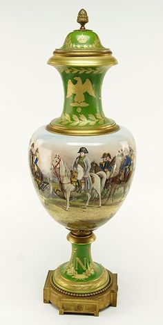 "A French Sevres Porcelain Covered Urn. Decorated with Napoleonic scenes and emblazoned with a stylized ""N"" and eagle. Side of urn is signed H. Desprez, Sevres"""