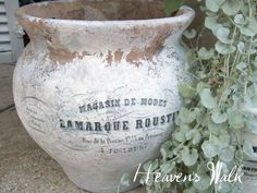 Terracotta pots, painted with a white wash, then mod podged with french typography.