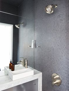 At His 350-Square-Foot Apartment, Small Space Champion Graham Hill Practices What He Preaches - Photo 10 of 15 - The wet bathroom, clad in Savoy penny tile by Ann Sacks, helped optimize the home's petite footprint.