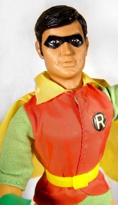 """Close-up of 12"""" vinyl Robin action figure, with magnetic hands capable of holding various magnetized accessories, based on the DC Comics character first introduced in the Batman series of comic books, part of the World's Greatest Super Heroes range of toys, United States, 1979, by Mego Corp."""