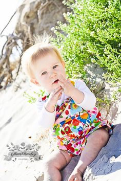 Today's fan photo of the day is provided to us by Gillian Beechey of Victoria, Australia! Gillian is a photographer by hobby and sent us these lovely photos of her baby girl in our cotton shortall in summer garden print. The floral print blends so well with the natural look of the sand and plants. Great job with the photos! And thanks again for sharing!