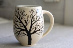 Belly Tree Mug - Pottery Coffee Cup with hand painted tree in Cream and Light Blue. $30.00, via Etsy.