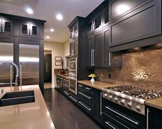 love all the black and how the cabinets go to the ceiling