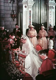 Prince Rainier and Grace Kelly kneel before the altar during their wedding ceremony at Saint Nicholas Cathedral, April 19, 1956.