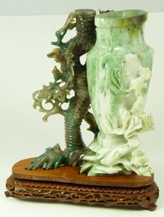 CHINESE HAND CARVED JADE FIGURAL VASE URN  Old Chinese hand carved jade urn having a figural vase design with tree and bird. Includes fitted wooden base.