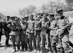 A meeting of Red Army and American troops at the bridge over the river Enns near Liezen, Austria, May 1945.