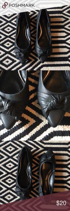BCBGIRLS Black shoes. Flats. Good condition. BCBGIRLS shoes. Flats. Black. Front knot. Size 7 1/2. Leather Upper. Man made sole. BCBGirls Shoes Flats & Loafers
