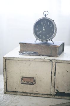 Industrial File Cabinet~ love the clock and book with the pages facing out.