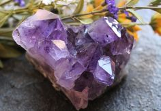 Amethyst Cluster, AME10  A sweet cluster that will enhance any collection and bring light to your home. Locality: Brazil Size: 3.0 x 4.0 x 3.0 The largest point is 2.5 long.  Amethyst is the purple ray of the quartz family that gets its purple coloring from manganese and iron inclusions. The name comes from the Greek word meaning not drunken, hence its association with remaining sober and abstaining from alcohol.  It is a calming stone that works on the emotional, spiritual, and physical…