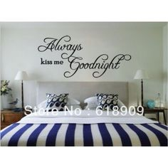 Lovely wall decor writing above the bed.