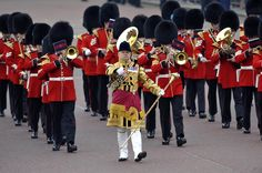The Royal Wedding Marching Band is a marching band of the Irish Guards, led by an Irish Wolfhound, marching along the Mall in London ahead of the Royal Wedding on April 29, 2011.