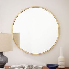 Round Wall Mirror - Antique Brass. This would look lovely in your guest room. The brass would break up the dark wood items.