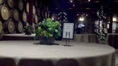 Floral centerpieces feature black calla lilies, succulents and cabbage.  Flower by Petal Town Flowers