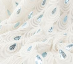 Ss Teardrop Emb Sequins Ivory/peacock Blue..... I wonder if we could use this to make the flower girls' dresses... or something...