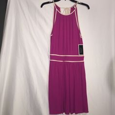 Juicy Couture Dress This is a gorgeous Juicy Couture fushia dress with cream details and an open back, it has a J on the zipper. It's brand new, never worn before with tags! It's a nice dress for a night on the town or a romantic date Juicy Couture Dresses Mini