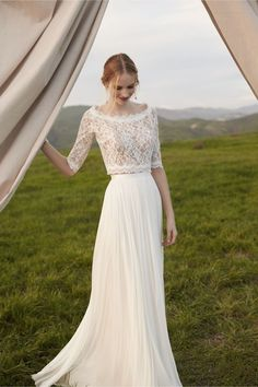 Lovely two peice wedding look. Lace top with sleeves paired with a tulle skirt. Love!