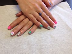Teal silver glitter pink and purple with chevron accent nail  Oasis Salon and Spa Mill Hall Pa (570)726-6565
