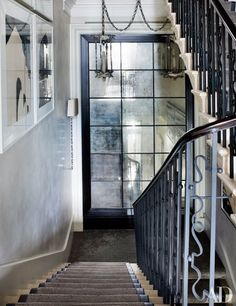 The stairwell of this London townhouse features antiqued-mirror panels and a balustrade modified to a style. London Townhouse, South Shore Decorating, Villa, Grand Homes, Interior Exterior, Interior Design, Architectural Digest, Architecture Details, Gothic Architecture