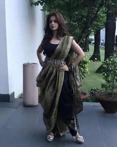 This saree is draped over a black dhoti pant and a tank top dresses up for in a melange of east and west Indian Gowns Dresses, Indian Fashion Dresses, Dress Indian Style, Indian Designer Outfits, Indian Outfits, Fashion Outfits, Indian Attire, Saree Fashion, Trendy Sarees