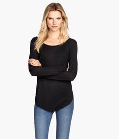 Long-sleeved top in soft jersey with a slight sheen. Gently rounded hem.