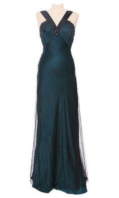 1940s dress.  Love it!  Wish I had something to wear it to....