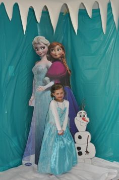 foam board and spray glue with frozen poster/ also love this icicle border