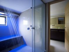 Stunning Shower Room With Blue Light Color And Glass Partition - pictures, photos, images