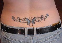 tatouage femme tribal papillon