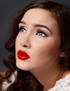 Classic Makeup is very polished. Deep Red Ruby Lips and clean eyes with some eyeliner and mascara add a pop to an outfit, and soften the face.