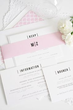 Black and white Urban Vintage wedding invitations with a blossom pink scallop envelope liner, blush pink belly band, and contemporary monogram complete with vertical lines and bold block type | Shine Wedding Invitations