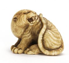 Masanaga - Snarling Tiger - Ivory Netsuke. Early 19th Century. Very fine detailed expression. Signed